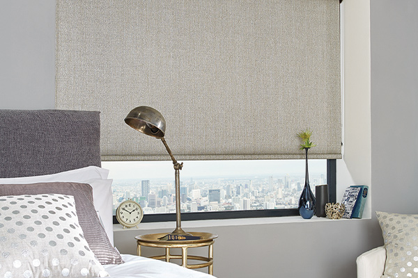 Stylish apartment with roller blinds in main bedroom