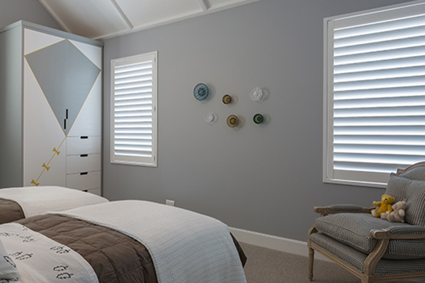 Grey bedroom with white shutters