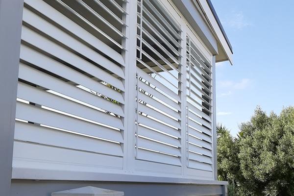 Exterior shutters on corner of outdoor living