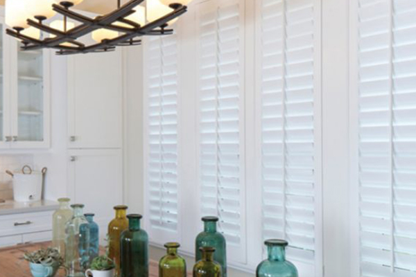Closed adjustable shutters above kitchen table