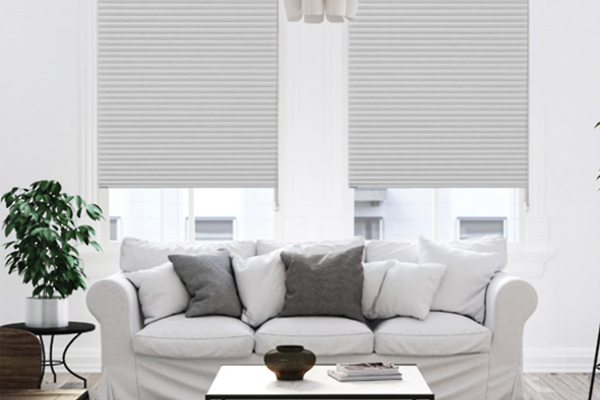 White lounge area with dual thermacell blinds