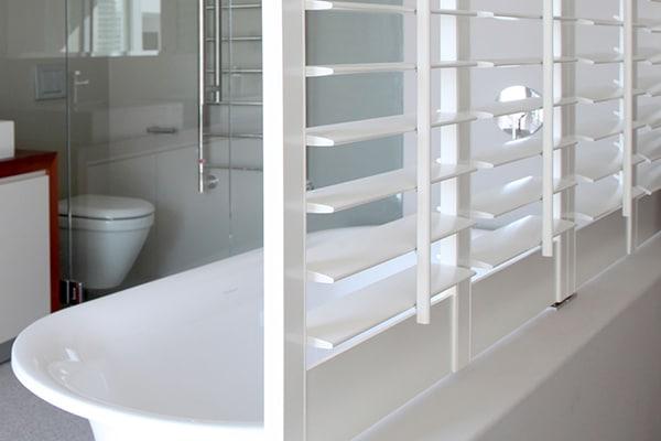 Woodlore waterproof shutter beside bath